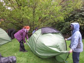 Girls put up their own tents