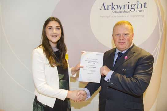 Georgina received her award from a representative of The National Grid