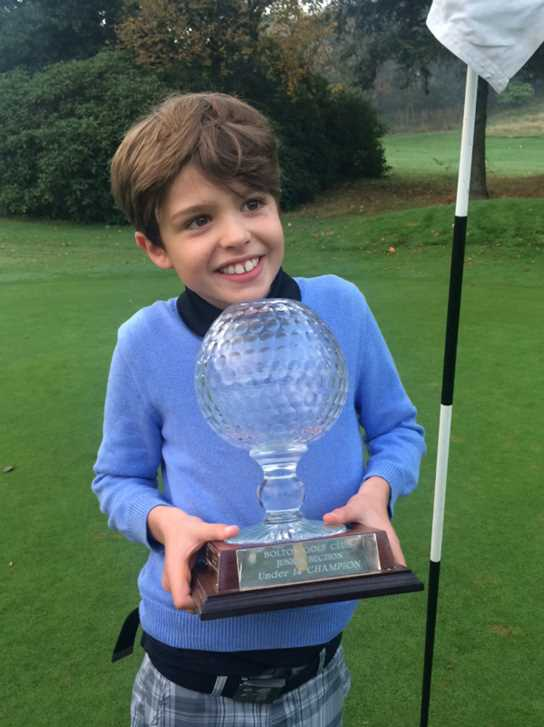 Toby with the Bolton Golf Club U14s trophy