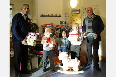 Lions Babu Roye and Bill Laithwaite were delighted with Beech House pupils' mountain of toy donations