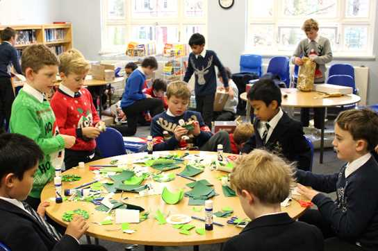 Making paper wreaths and wrapping 'presents' in the Library