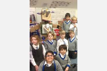 Pupils with the 'child' robot they built out of rubbish