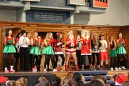 Year 10 put on a show to encourage pupils to post Christmas cards for charity
