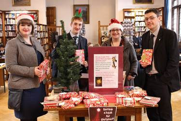 Year 13 students Olivia Ramsdale and Nicholas Thompson along with Librarian Mrs Caller and Biology teacher Mr Tillotson collect their books