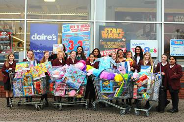 The Year 7 girls raised enough money to buy a huge amount of gifts for Mission Christmas