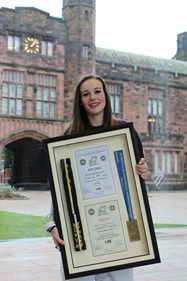 Beth with her certificates and Bronze medal from the competition