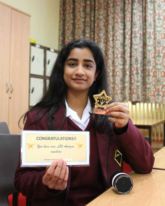 Shreya with the prize she won at the hackathon