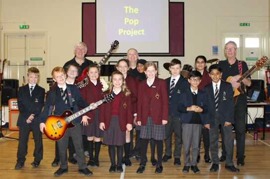 Pop Project performers Malcolm, Henry and Graham with some of the Junior School pupils