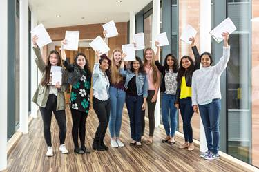 Girls celebrate their GCSE results at Bolton School in August 2015
