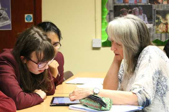Some members of the Creative Writing Group working with Mandy