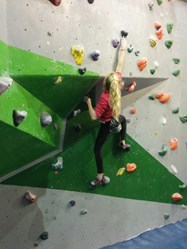 Bella climbing at the Hangar