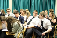 Year 12 pupils discuss ideas during the conference