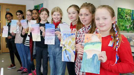 Some of the girls with their artwork featuring French landmarks