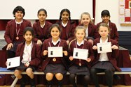 The U9 and U11 chess teams show off their certificates and medals