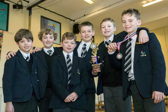 The Year 5 team with their cup and medals