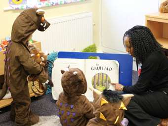 Tweenies dressed as the Gruffalo enjoy the book together