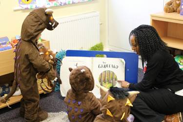 Tweenies dressed as The Gruffalo enjoy the storybook