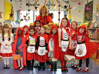 Lots of Little Red Riding Hoods - including Mrs Taylor!