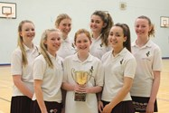 The victorious Under 14 Netball Team with their trophy