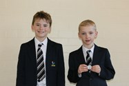 Henry and Stephen both won Silver medals in Downhill Ski Races over half term