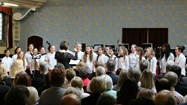 The Middle School Choir performing in Hulme Hall