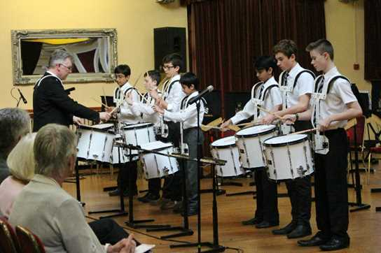 The Drum Corps performing in Hulme Hall