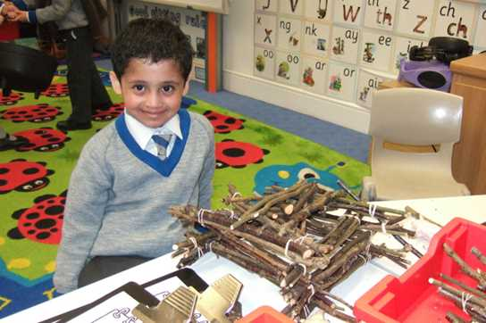 A pupil with his stick house