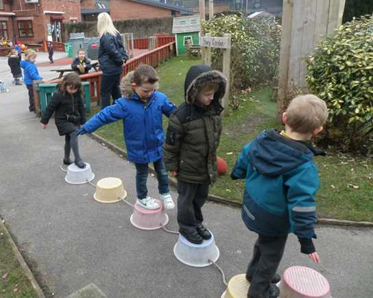 The children having fun doing the obstacle course