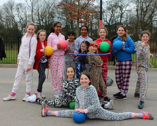 A group of girls in their pyjamas