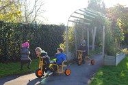 Children playing in part of the Nursery garden area