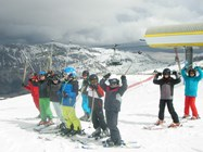 A group of skiers pose