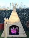 Children playing in the Teepee
