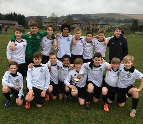 The Year 8 boys celebrate their 3-1 victory to win the Town Cup