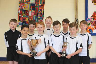 The Year 5/6 Team with their trophies