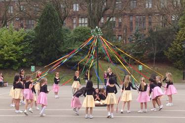 The Year 3 girls dancing around the Maypole