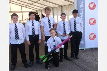 The Bolton School team: Max, Sami, Harry, Jacob, Ahmed, and Tom holding one of their rockets