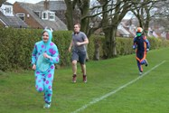 Running laps around the Levels in costume to raise money for charity