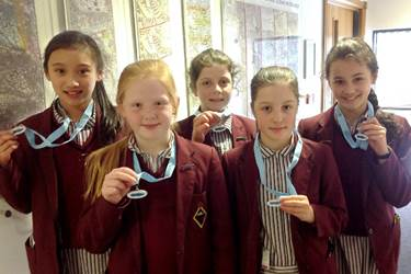 The team with their medals from the Championships: Bethany, Harriet, Anna, Lucy and Kiana