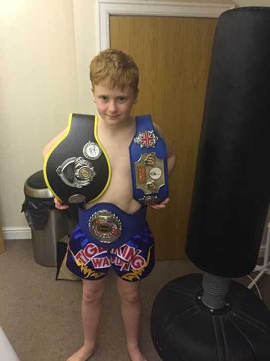 Marcus proudly shows off his three title belts