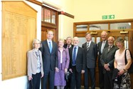 Headmaster Philip Britton with guests at the unveiling of the new Roll of Headmasters board