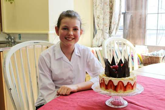 Yasmin with her winning bake: the Queen's Birthday Gateau