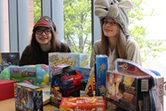 Emma Hussain dressed as The Gingerbread Man from Shrek and Isabelle Pearce as The Donkey from Shrek have helped coordinate the toy collection