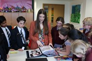 Flo talking to Year 6 pupils about her portfolio designs