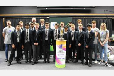 Pupils with the U20 Trophy and the 'Hands Up for Jonny Wilkinson's Right Boot' cast