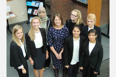 Caroline Plumb OBE (centre) with Girls' Division pupils at a careers event in School