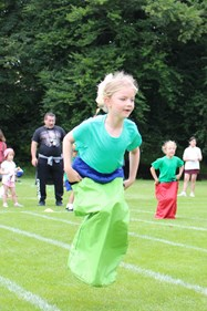 Hopping along in the sack race