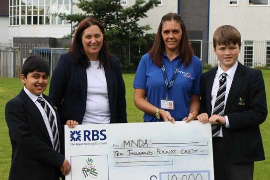 Ms Stacey Kerr of MNDA Manchester collected a cheque from the boys
