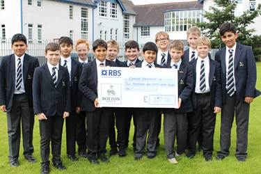 Year 6 boys with their cheque for Cancer Research UK