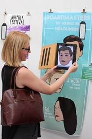 "Mrs Ryder demonstrates the ""virtual"" art - a face which cries on the laptop when placed over the poster"