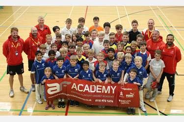 Lancashire bowler Glen Chapple with Cricket Academy participants and coaches